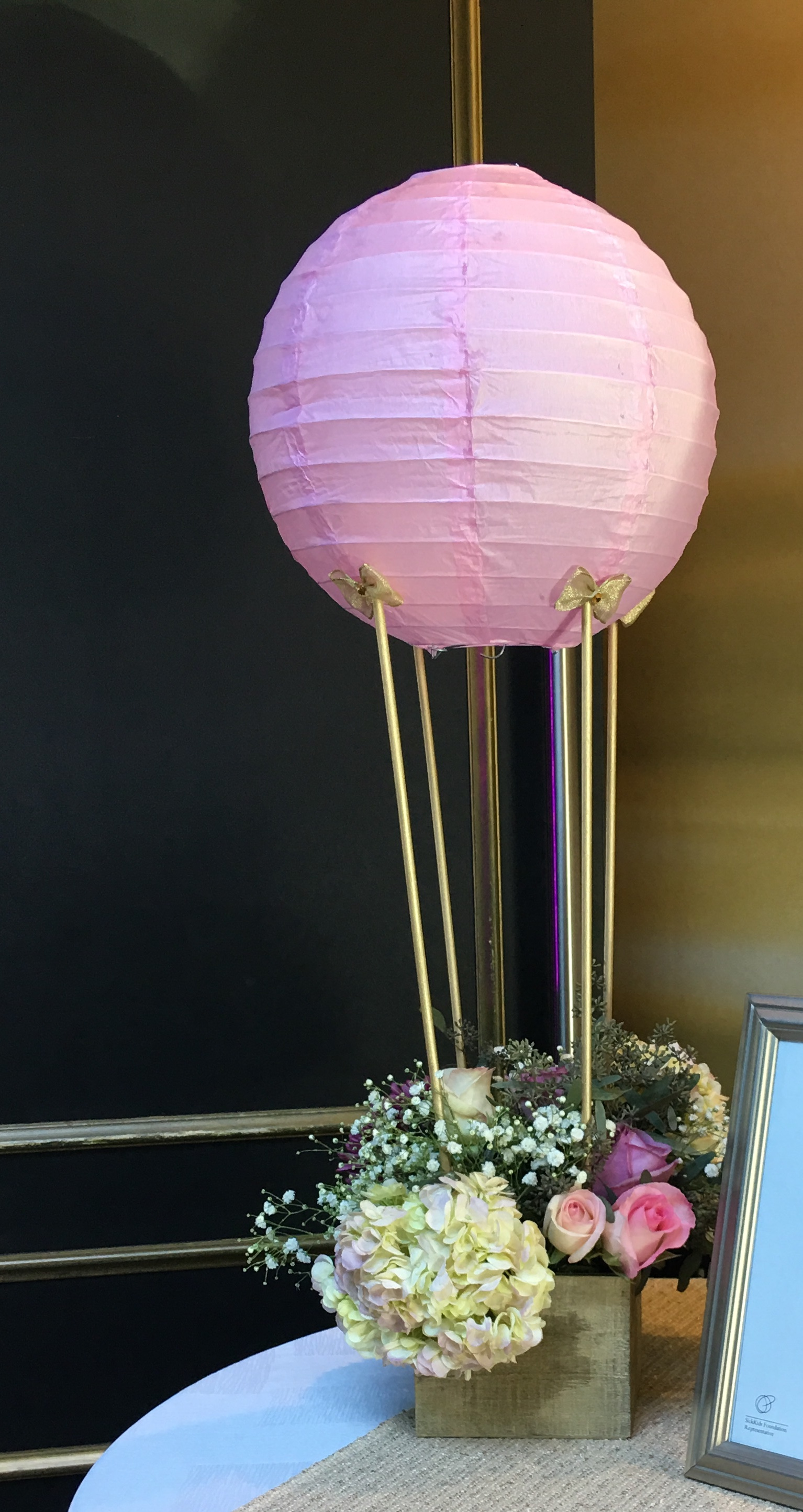 Hot air balloon centerpiece with flowers
